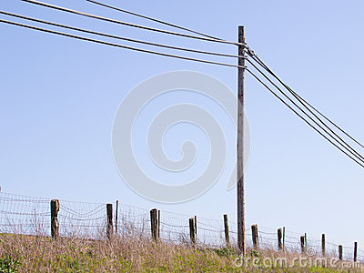 Simple Elements In A Rural Scene  Telephone Pole And Wires  Wire Fence