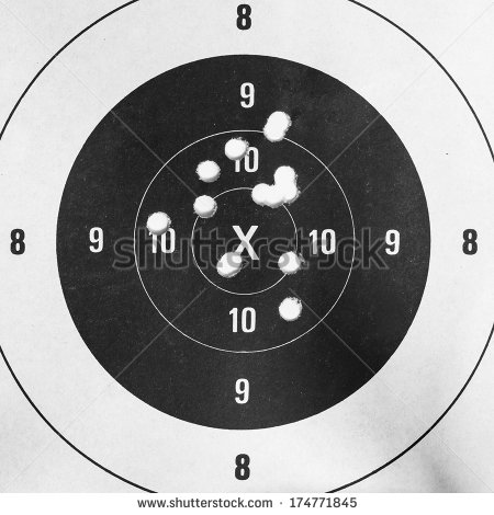 Up Of A Shooting Target And Bullseye With Bullet Holes 174771845 Jpg