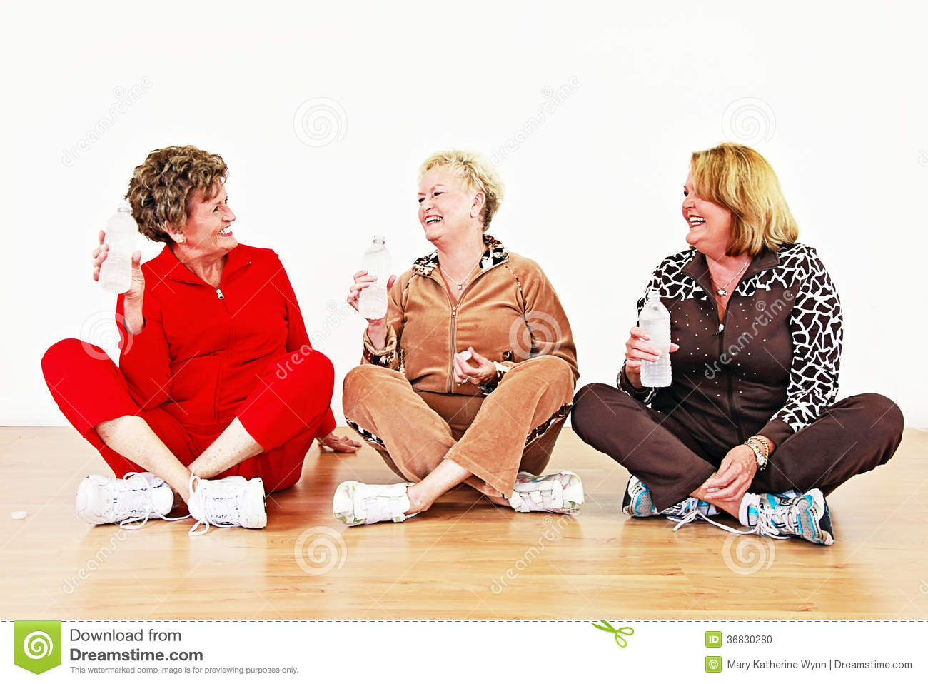 Senior Women With Water Socializing In A Row In An Exercise Class