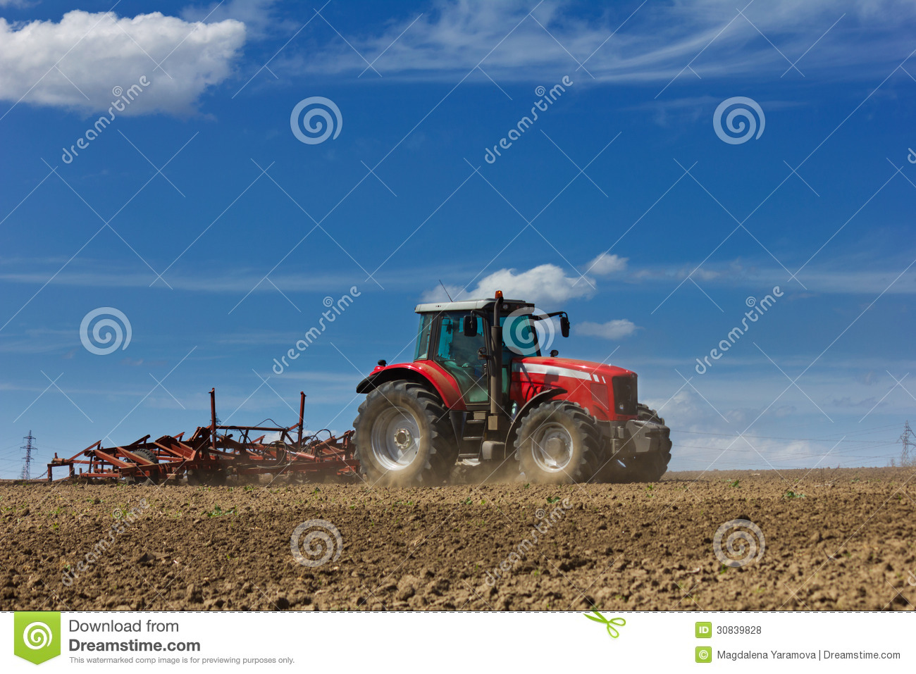 Plowing The Field  Cultivating Tractor In The Field  Red Farm Tractor