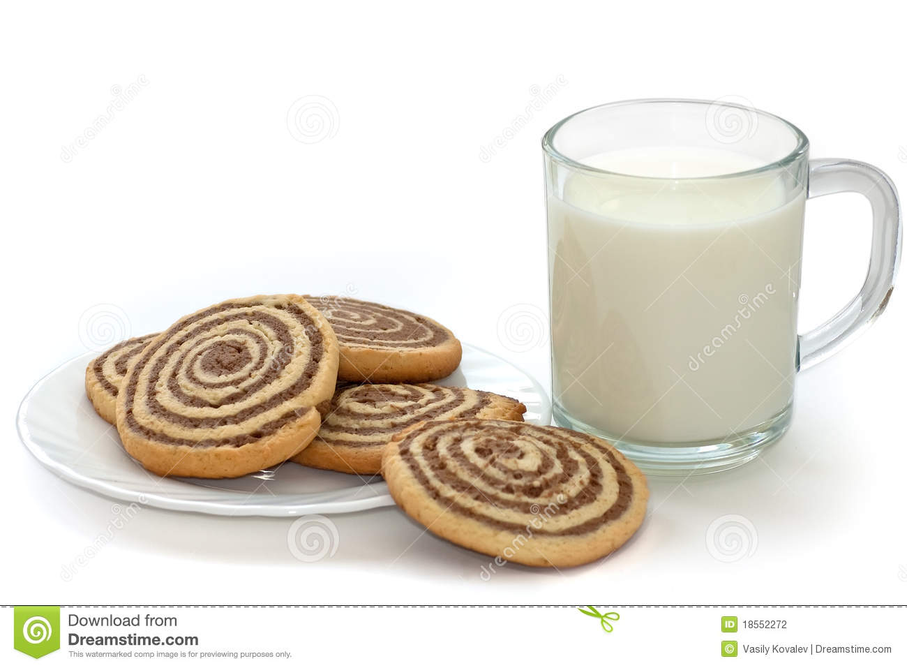 Black And White Cookies On The Plate With Cup Of Milk On White