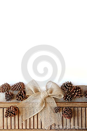 Burlap Ribbon Is Tied Into A Christmas Gift Bow Next To Vintage