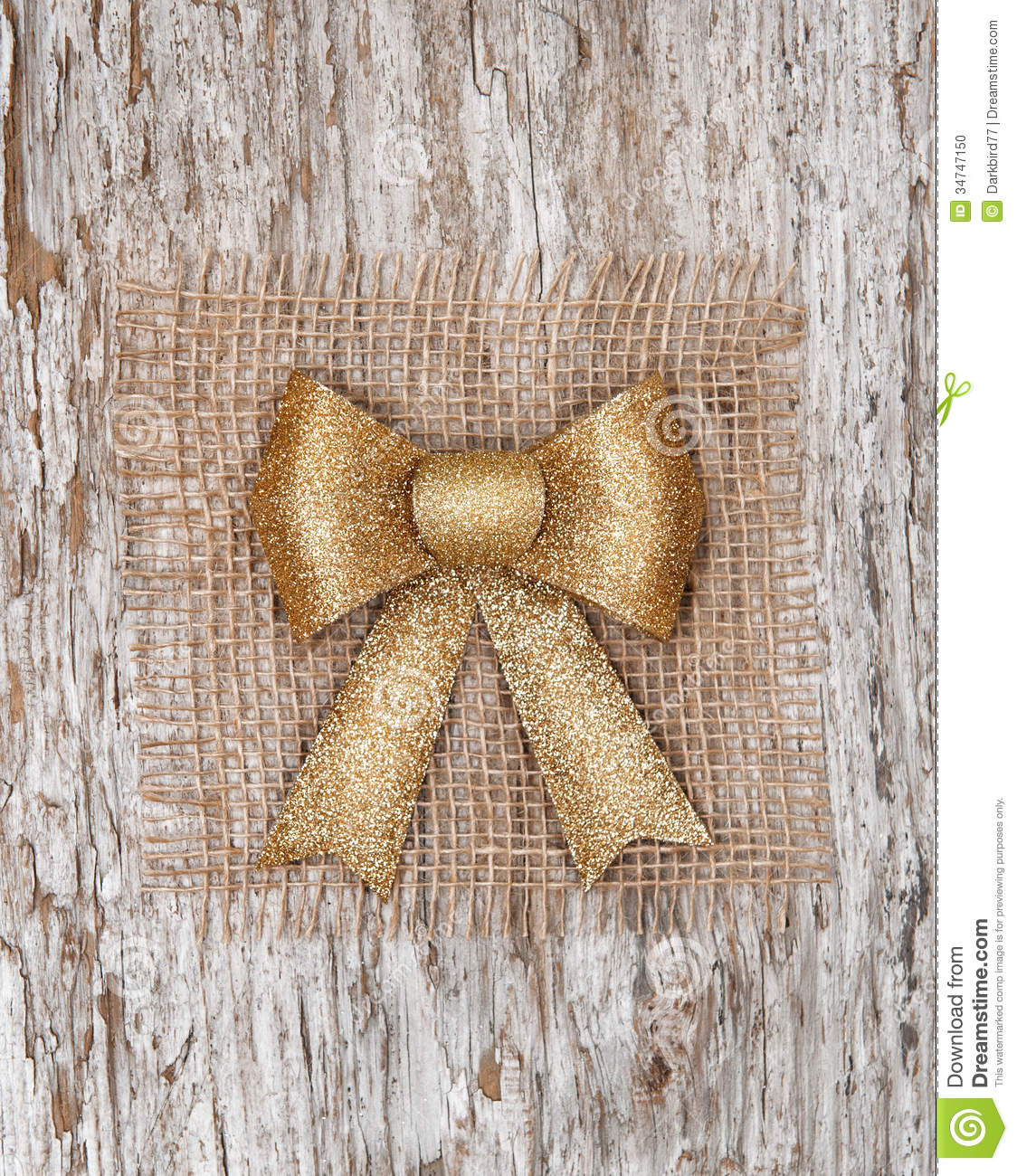 Golden Bow On The Burlap Textile And Old Wood Stock Photo   Image