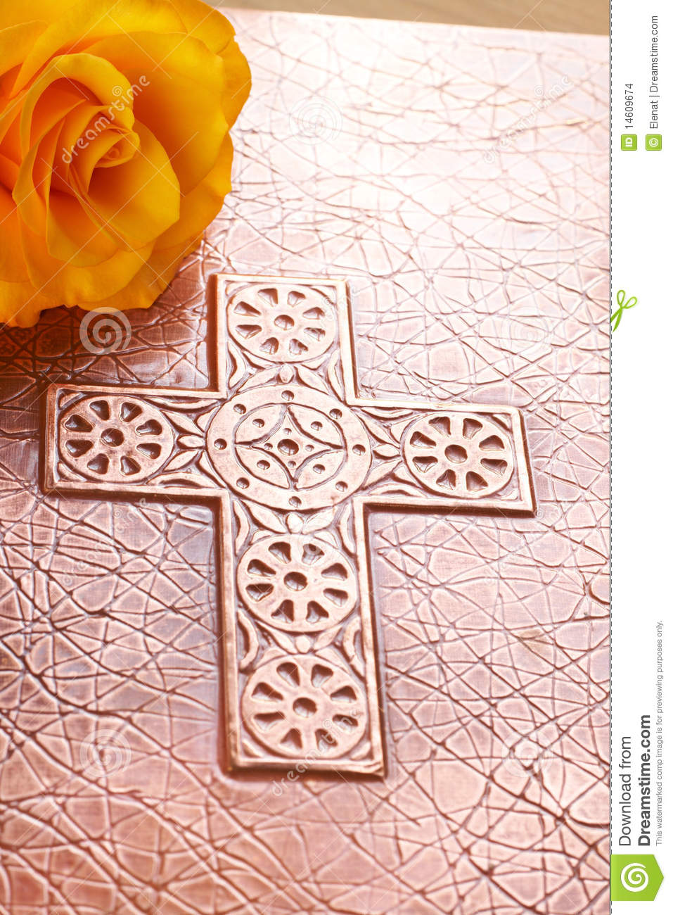 One Yellow Rose On The Bible With A Cross On The Bronze Cover