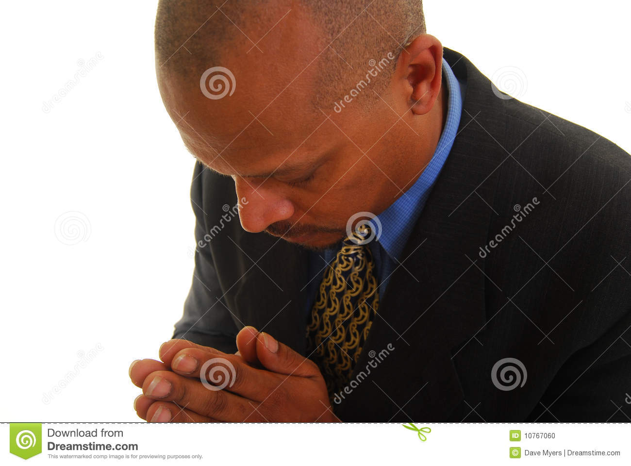 African American Man With Eyes Closed And Hands Clasped Praying