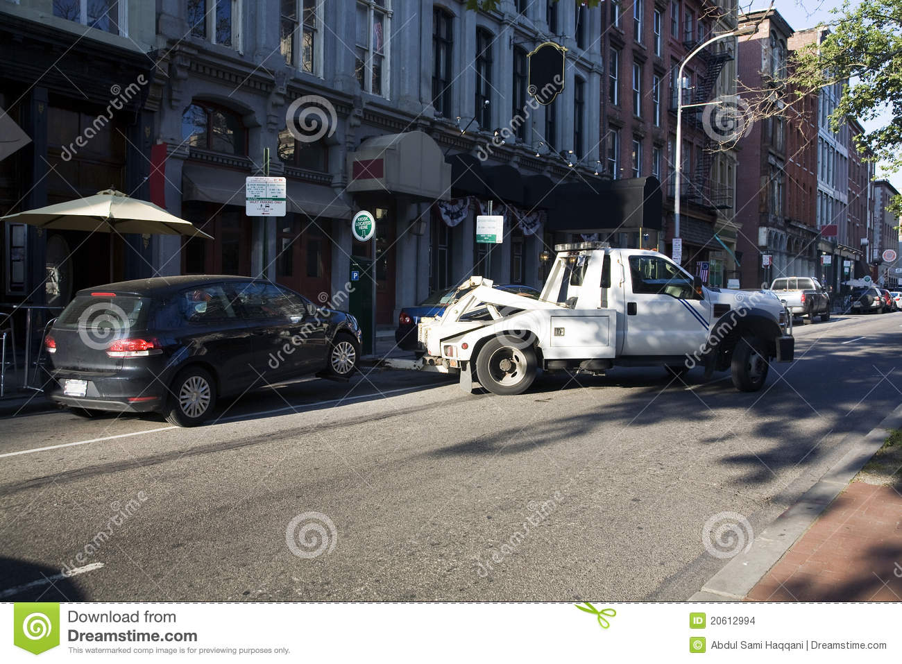Car Being Towed Away By Truck Due To Illegal Parking