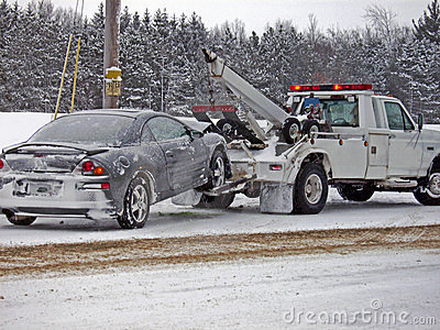 Wrecker Towing A Car In Winter Stock Image   Image  5420911