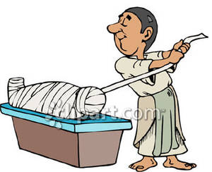 Egyptian Man Wrapping Up A Mummy   Royalty Free Clipart Picture