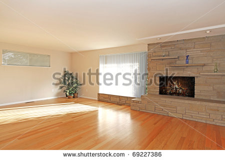 Large Empty Living Room With Stone Fireplace In Asian Style Stock