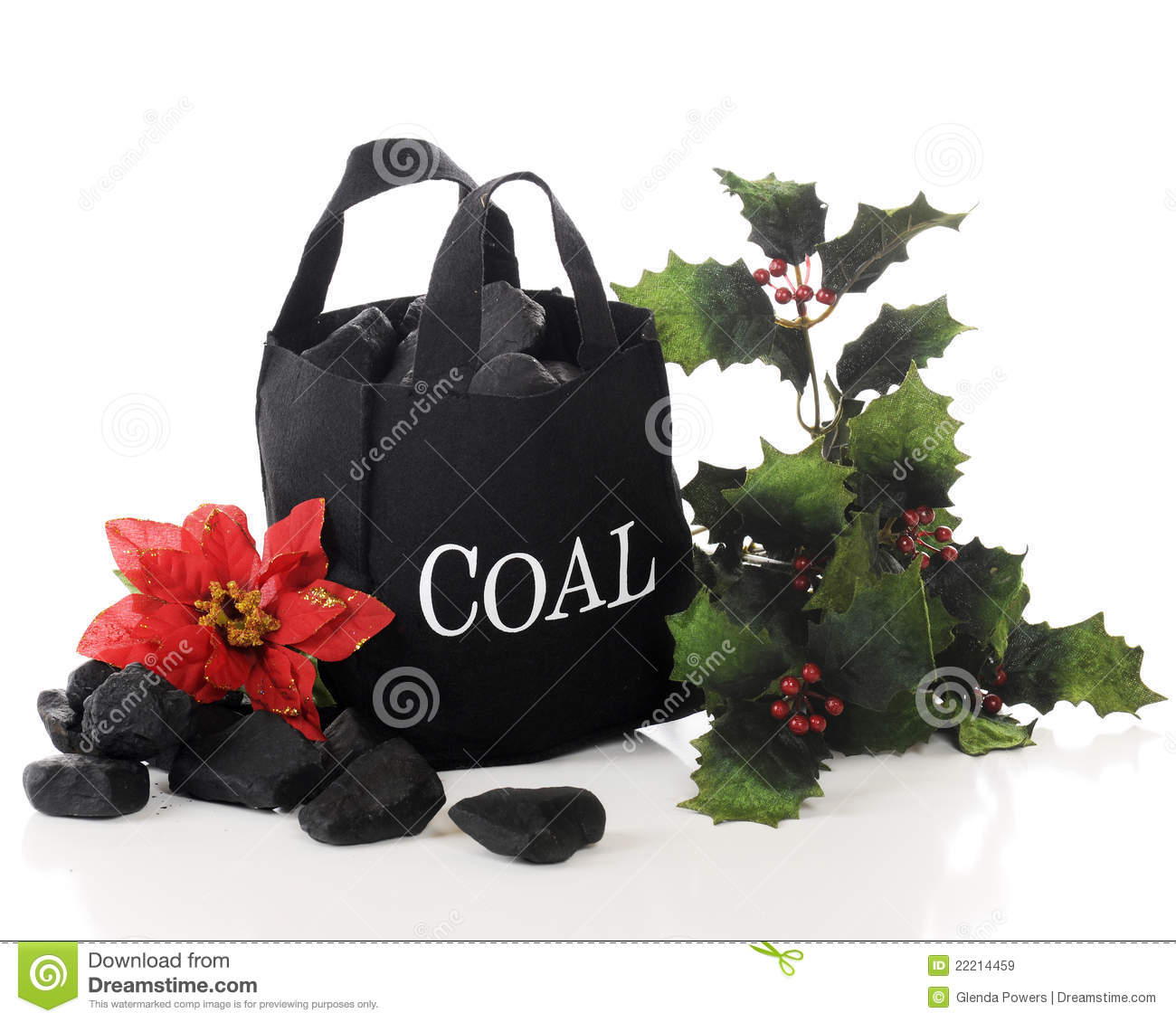 Small Black Bag Of Coal Adorned With A Poinsettia And Sprigs Of