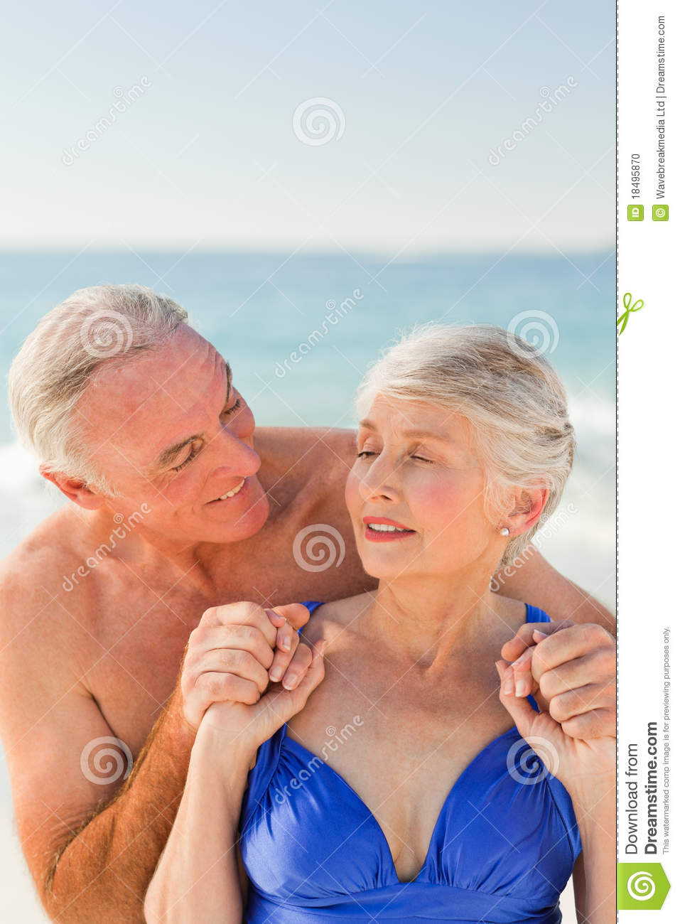Man Hugging His Wife At The Beach Stock Photo   Image  18495870