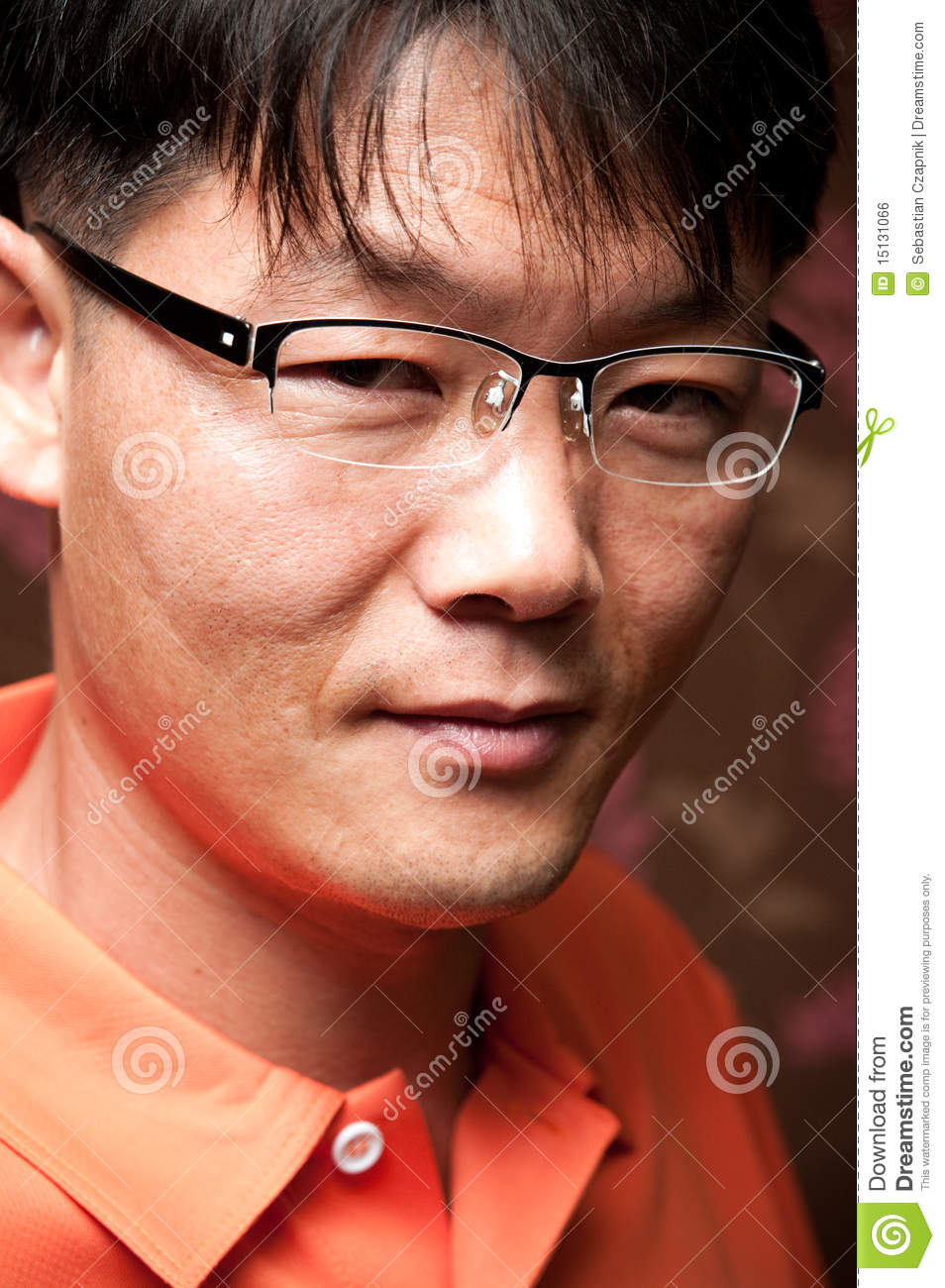 Portrait Of A Handsome Young Asian Man Wearing Glasses
