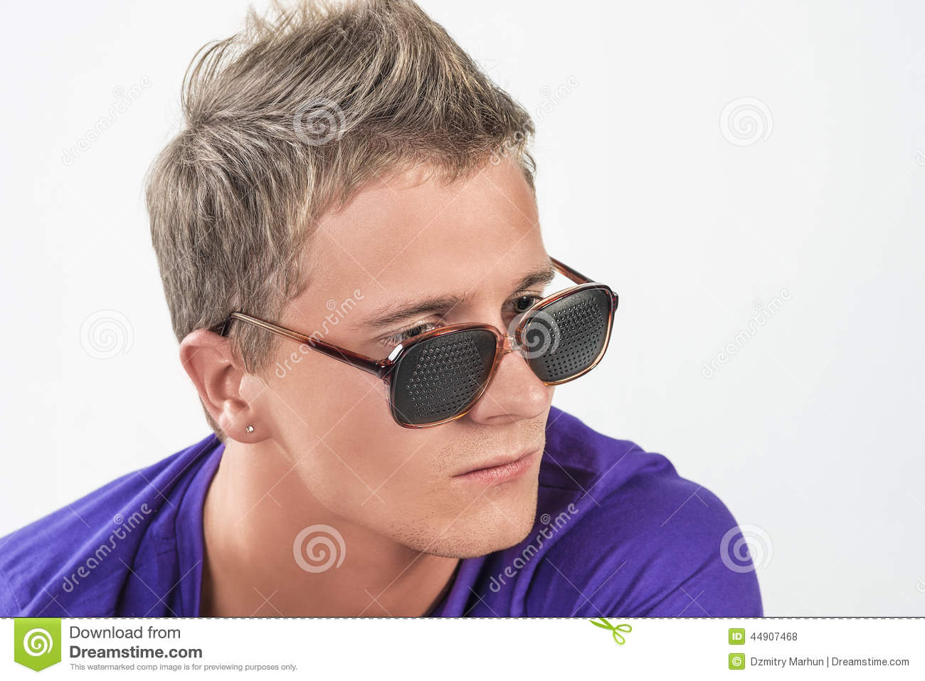 Young Caucasian Man In Eyeglasses Staring Away Stock Photo   Image