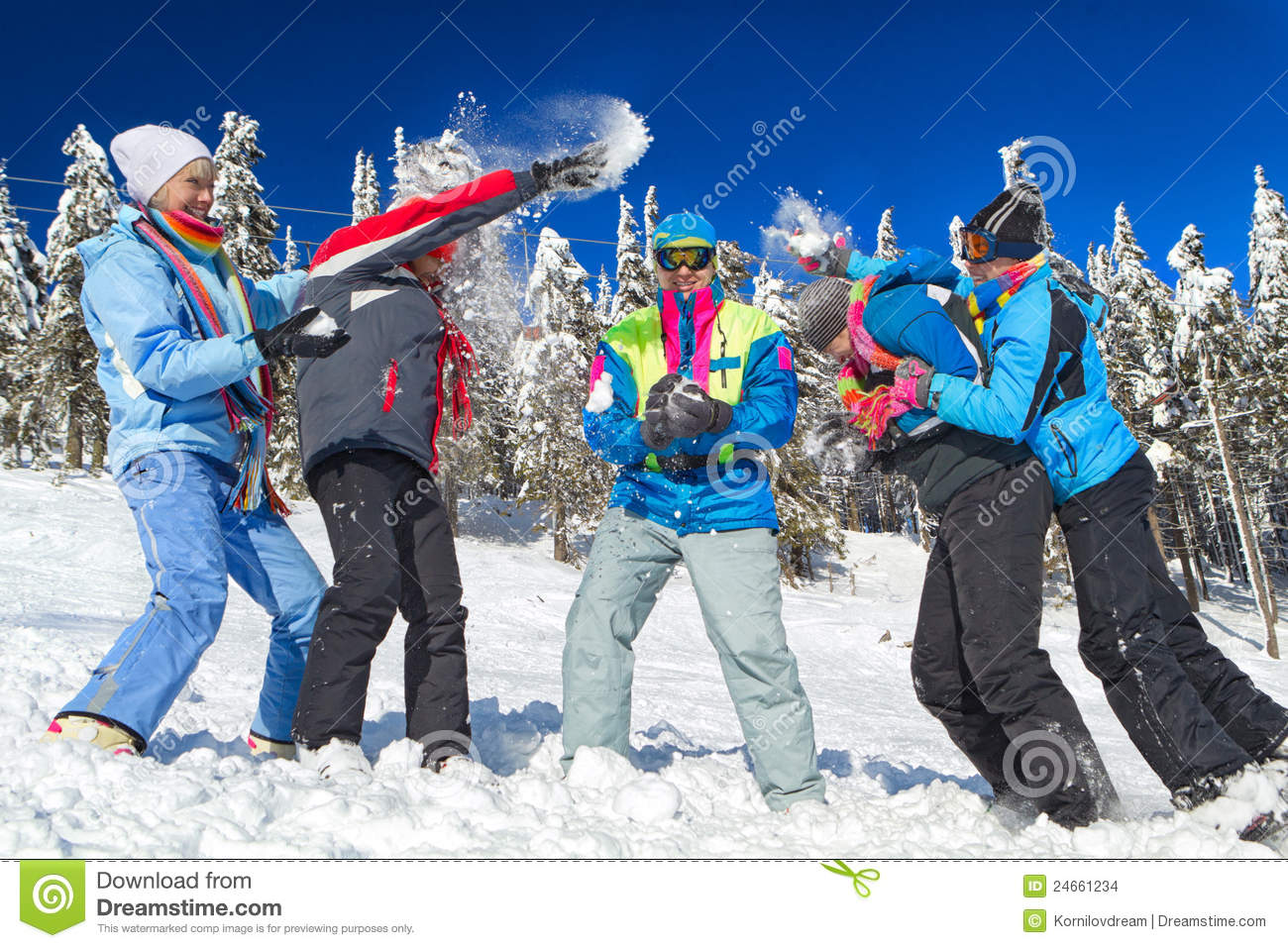 Yuong People Having Snowball Fight In Snow In Winter Background