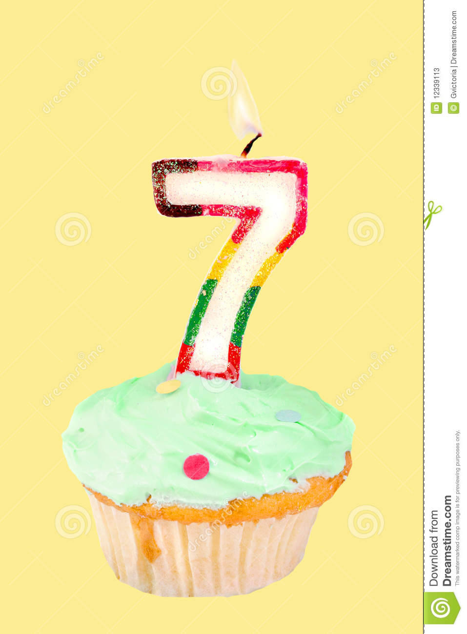 Seventh Birthday Cupcake With Green Frosting On A Yellow Background