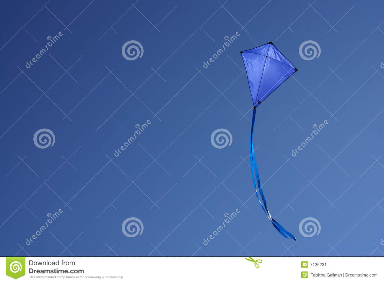 Blue Kite In Clear Blue Sky