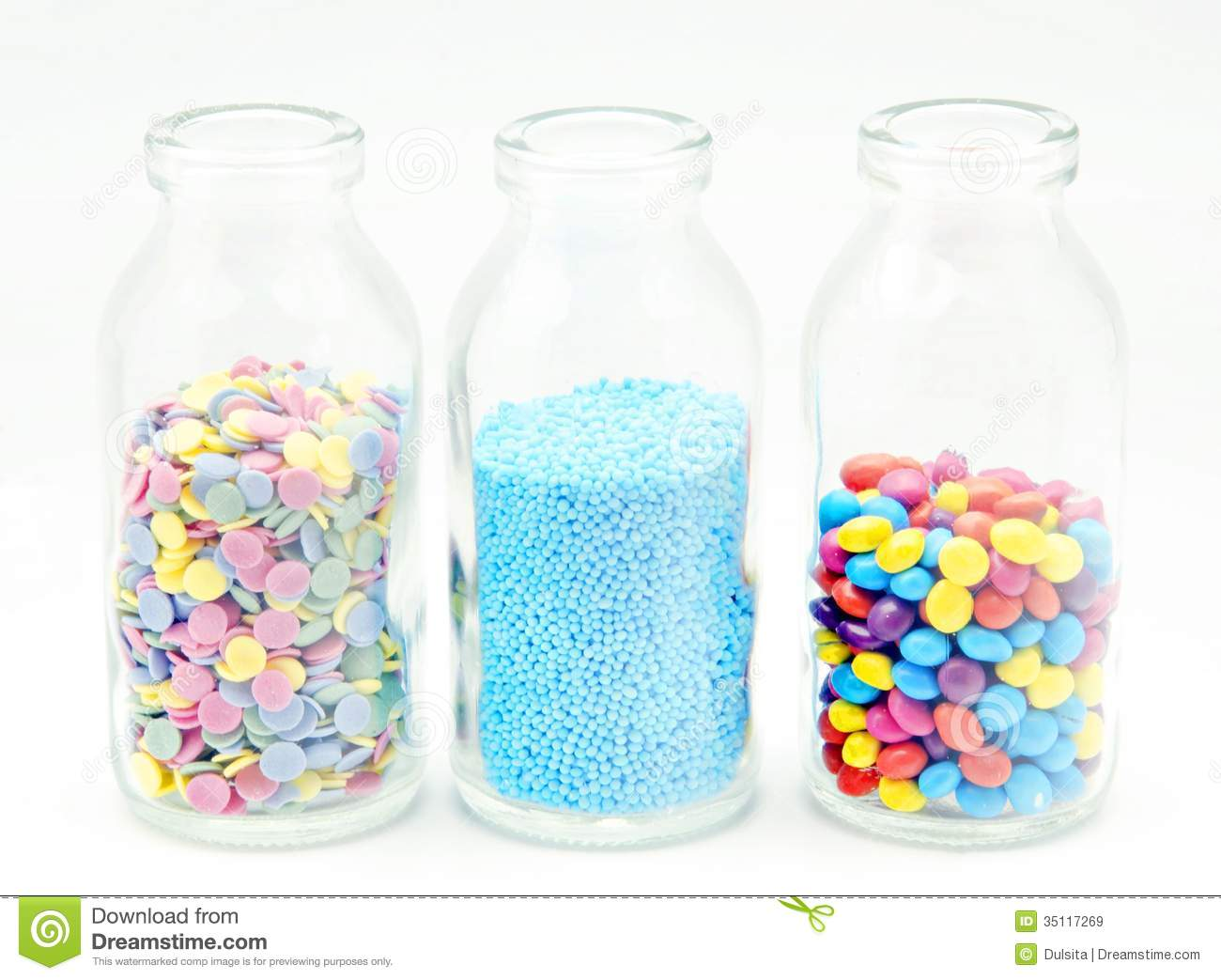 Candy Sprinkles On A Glass Bottle On White Background