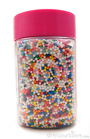 Colorful Sprinkles For Cake Decoration In A Jar With Pink Lid