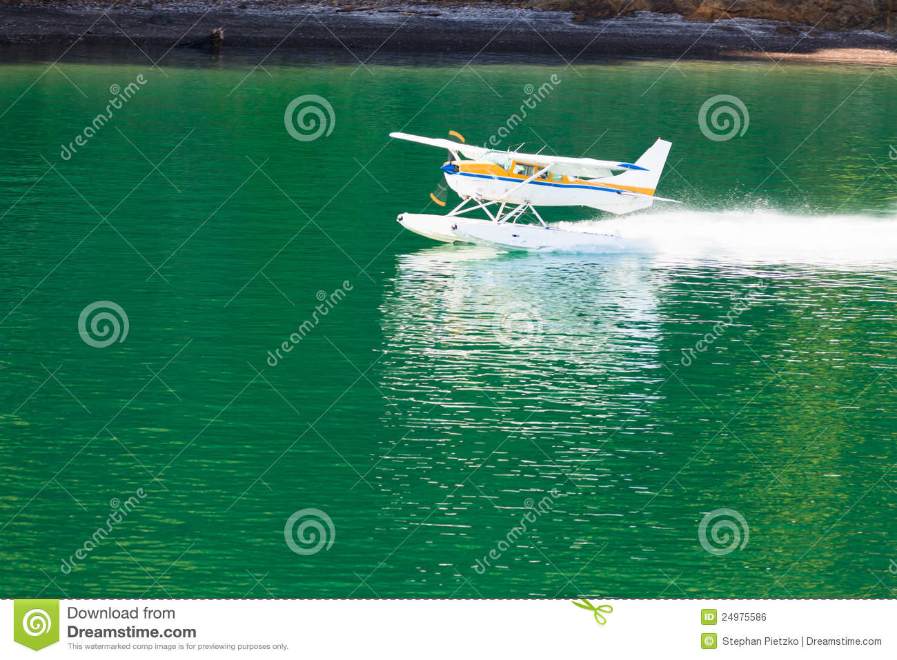 Aircraft Seaplane Taking Off On Calm Water Of Lake Royalty Free Stock