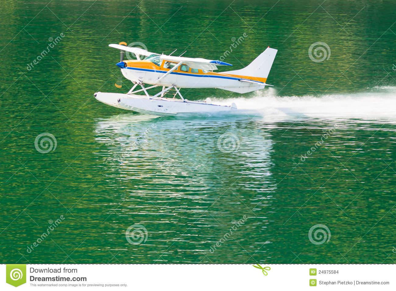 Float Plane Or Hydroplane Takes Off Across Flat Calm Water Of Lake