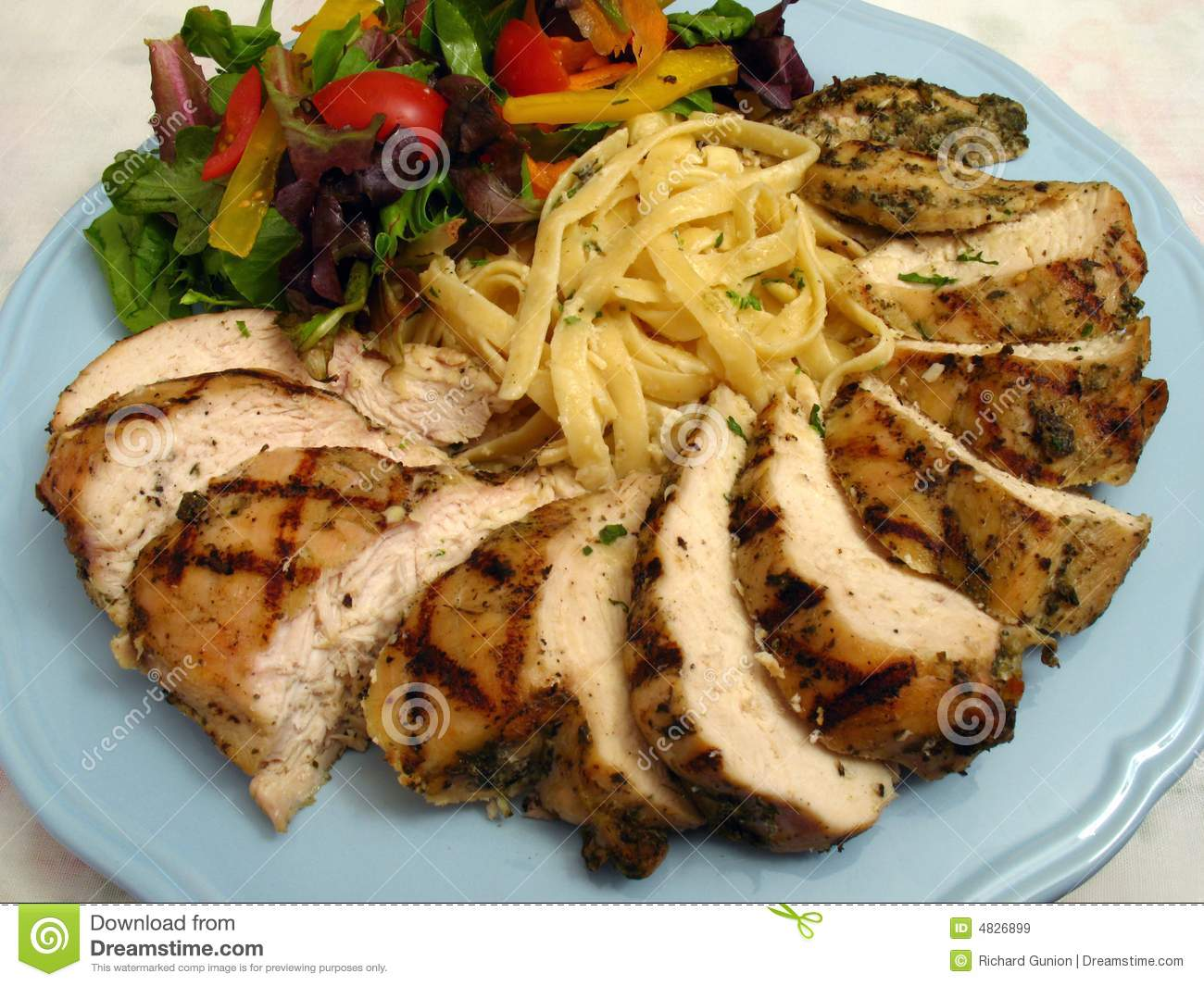 Photo Of Grilled Chicken And Fettuccine Alfredo Dish Served With Salad