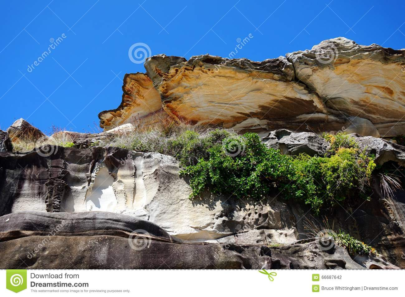 Side Sandstone Cliffs And Rocks Weathered By Wind And Water Erosion