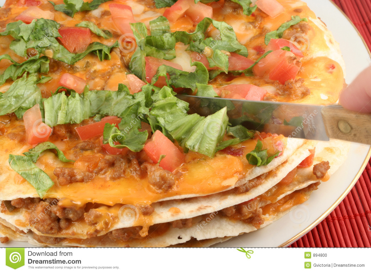 Cutting Into A 4 Layer Soft Taco Mexican Pizza