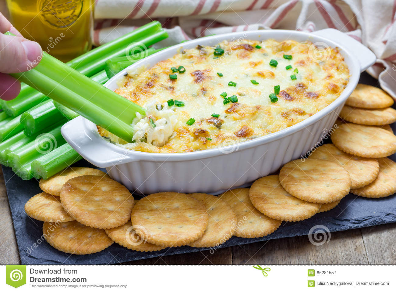 Baked Crab Dip Served With Celery Sticks And Crackers Stock Photo