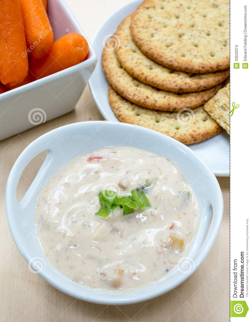 Creamy Crab Dip Surrounded By Vegetables And Crackers At A Party