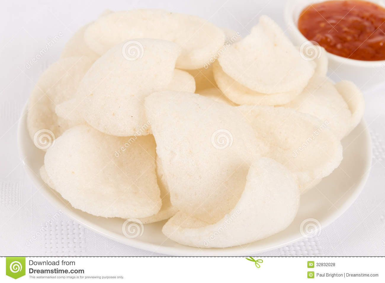 Fried Prawn Crisps And Sweet Chilli Sauce Dip On A White Background