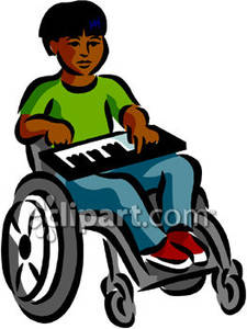 African American Boy In A Wheelchair Playing A Keyboard   Royalty Free