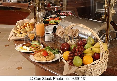 Breakfast Buffet With Eggs Waffles Fruit And Coffee