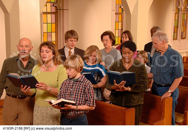 Church Congregation Singing Hymns In Church   Stock Photos   Royalty