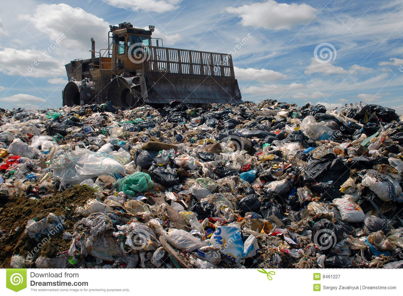 Royalty Free Stock Photography The Bulldozer On A Garbage Dump