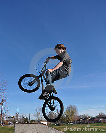 Teenage Boy On Bmx Bike In The Air Royalty Free Stock Photo   Image