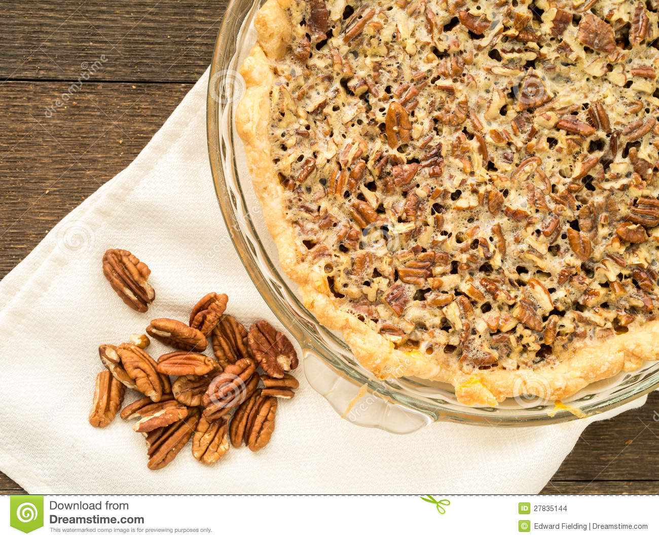 Fresh Baked Pecan Pie And A Pile Of Raw Pecan Nut Meats