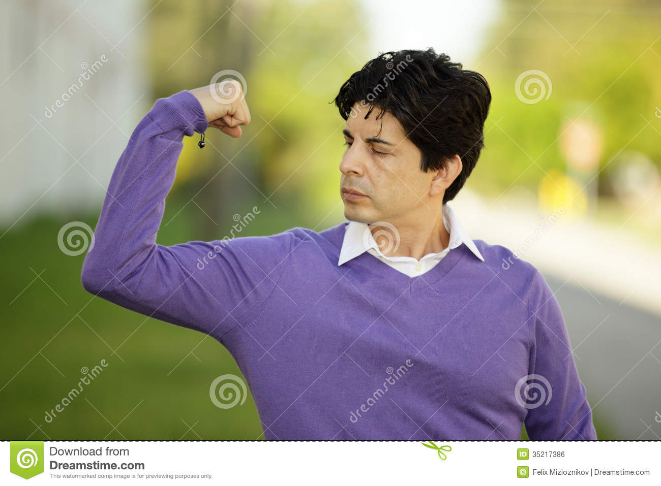 Weak Man Flexing His Muscles Royalty Free Stock Image   Image