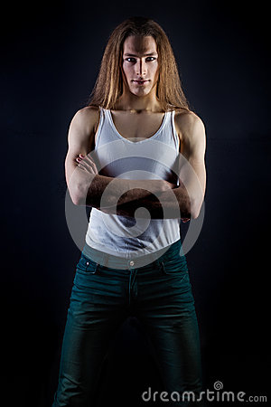 Posing In Studio On Black Background And A White T Shirt And Jeans