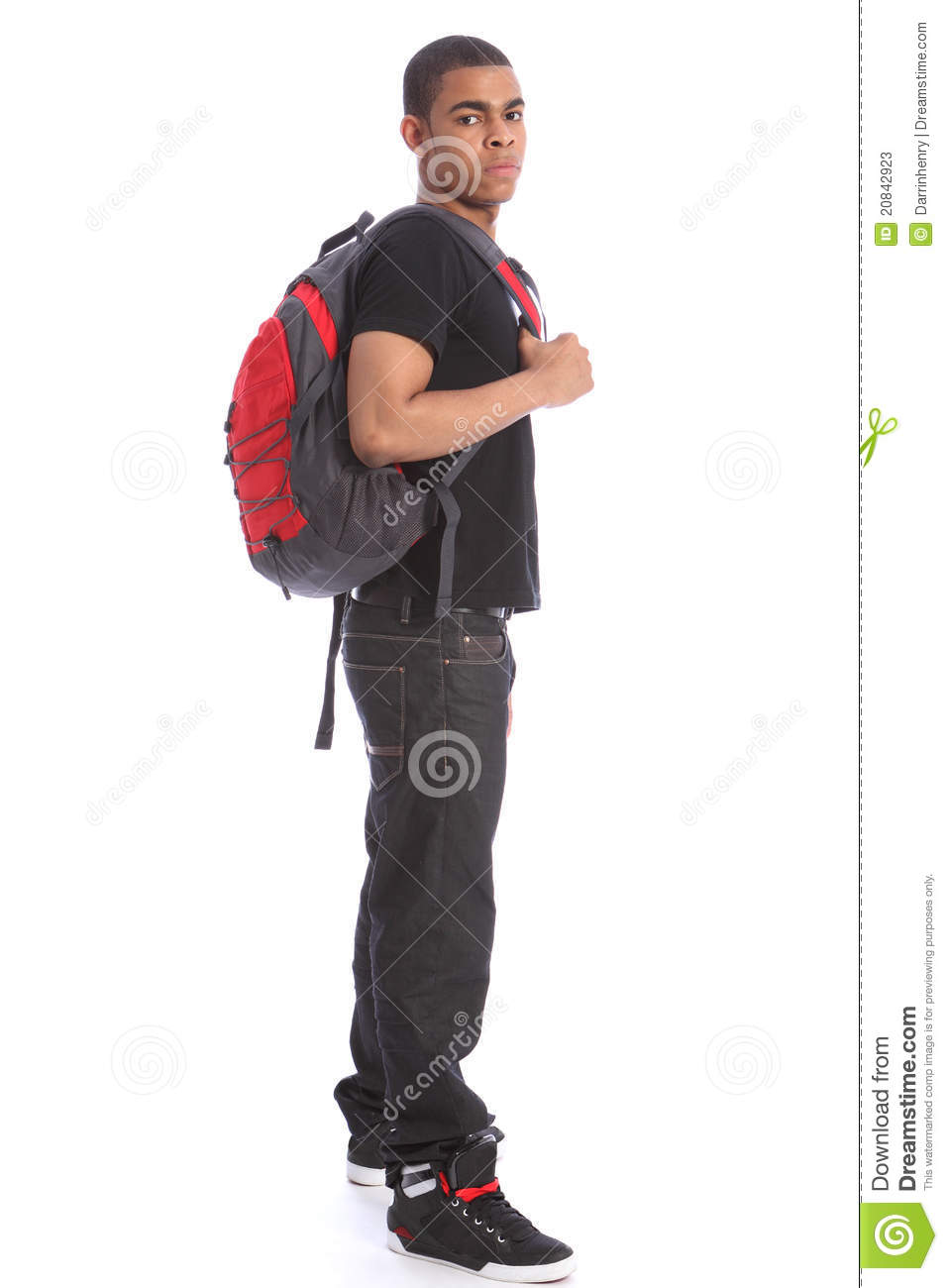 Student Wearing Jeans And T Shirt Standing With School Backpack