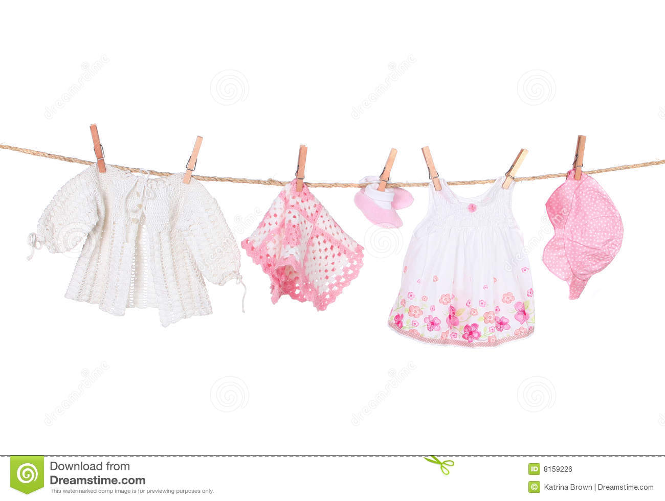 Baby Girl Clothing Hanging On A Clothesline Royalty Free Stock Image