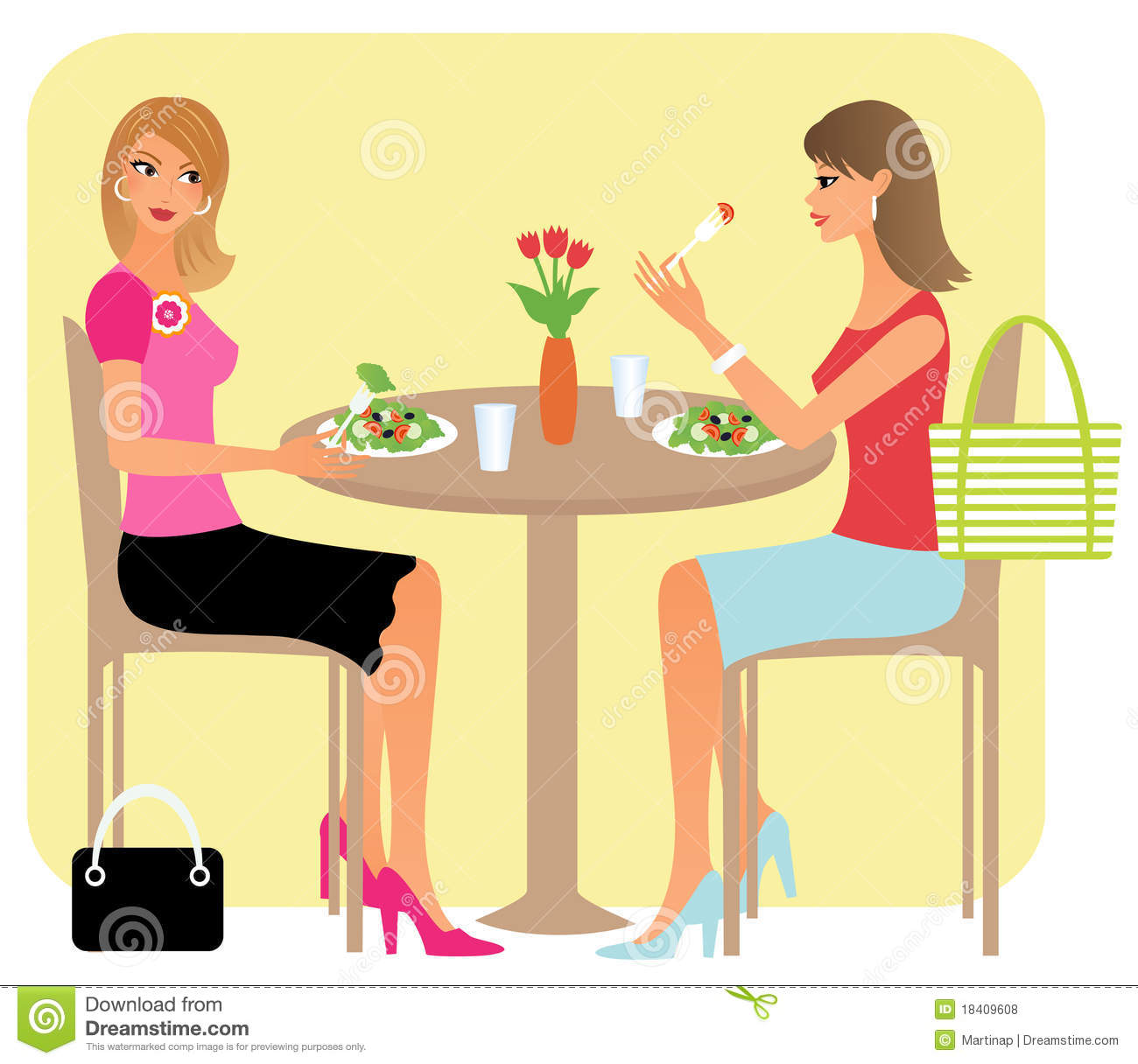 Two Attractive Girl Friends Chatting Over Their Lunch In A Restaurant