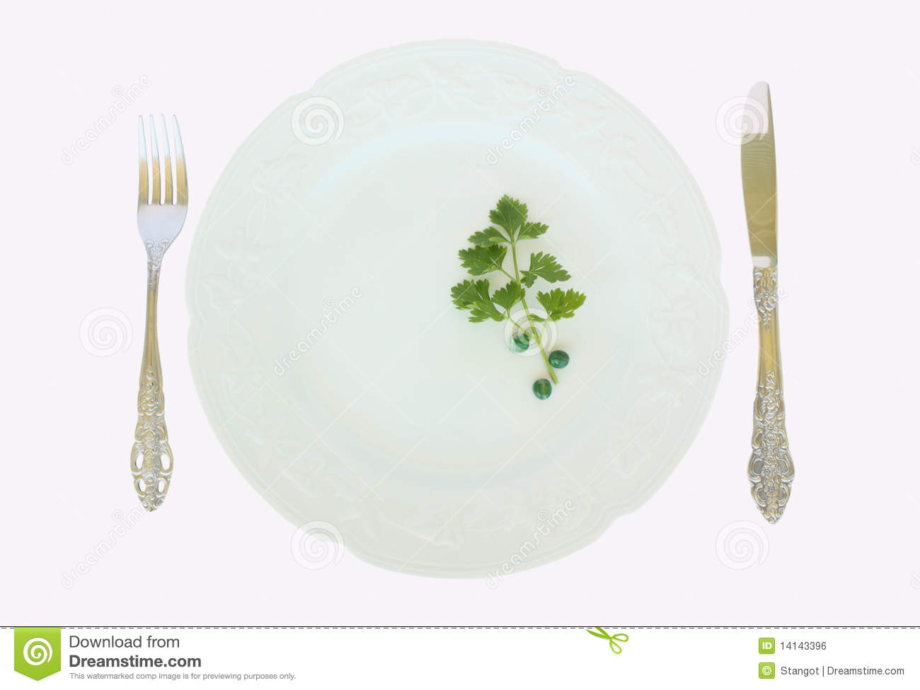 Dinner Plate With Peas And Parsley And Fork And Knife Arrangement