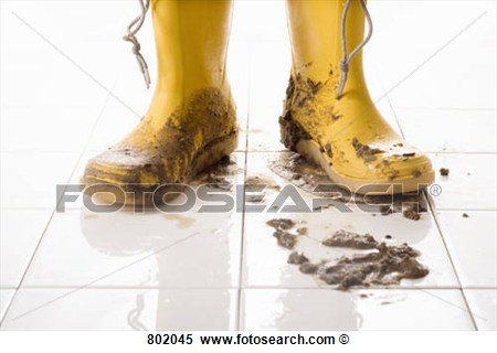 Stock Image   A Pair Of Muddy Rubber Boots  Fotosearch   Search Stock