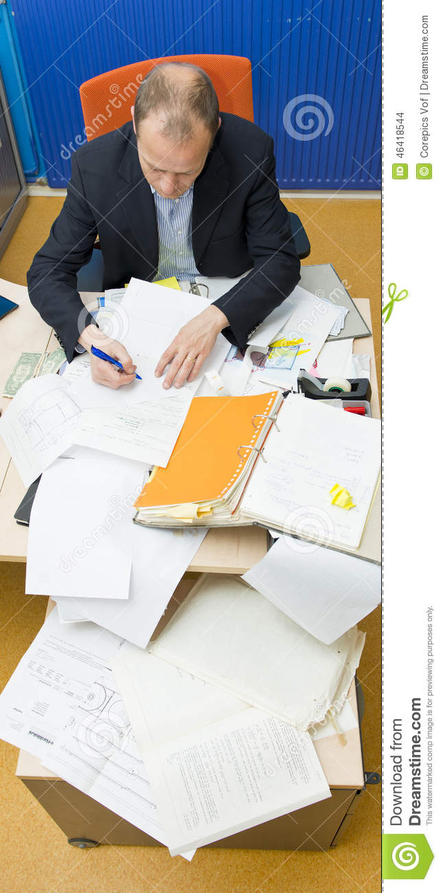 Cluttered Desk Stock Photo   Image  46418544