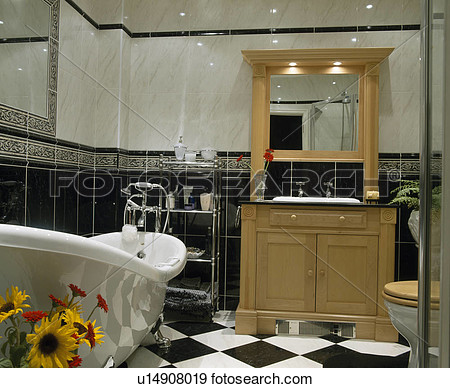 Bathroom With Fitted Mirror Above Basin In Pale Wood Vanity Unit View