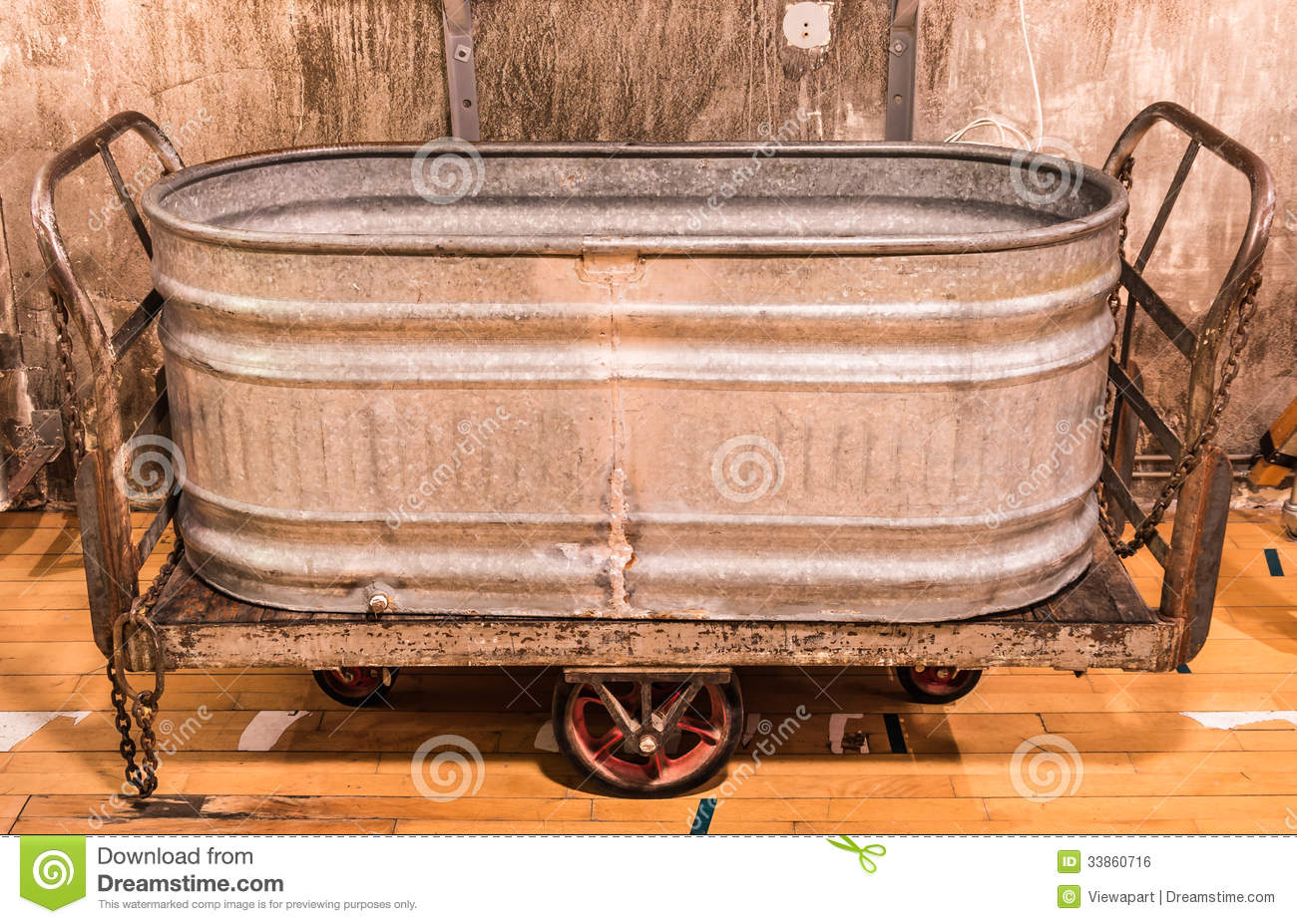 Vintage Bathtub On A Wooden Floor