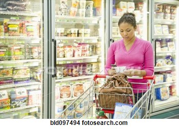 Mixed Race Woman Shopping In Frozen Food Aisle View Large Photo Image