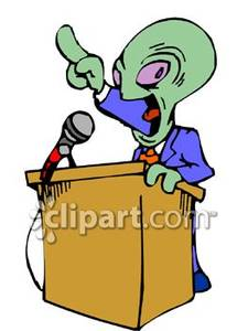 Public Speaker Is A Little Green Man   Royalty Free Clipart Picture