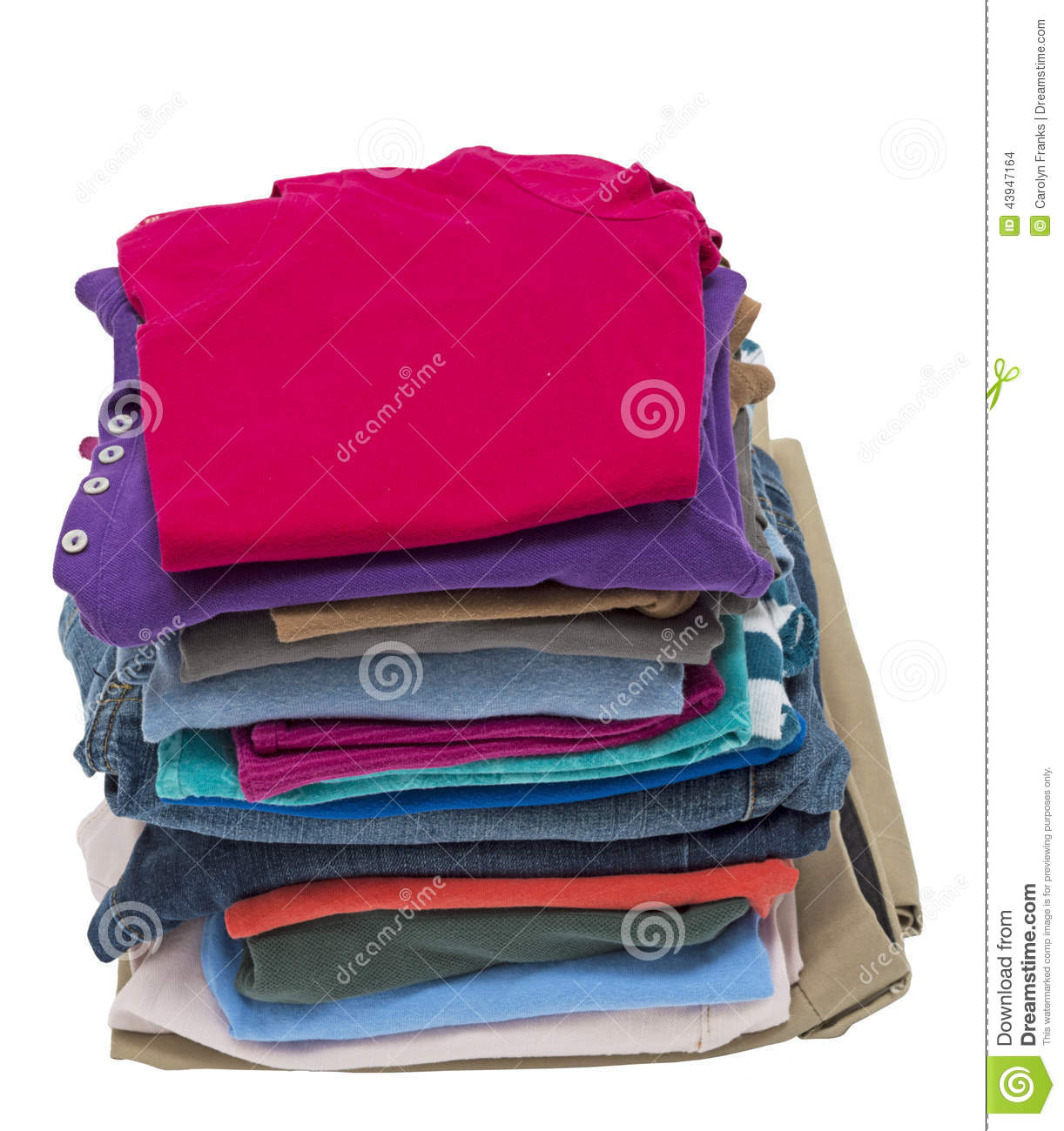 Beautiful Isolated Vertical Shot Of A Tall Stack Of Folded Clothing