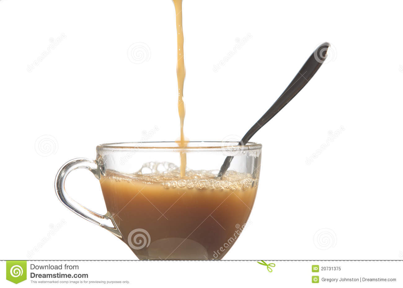 Pouring Coffee Into A Glass Cup Against A White Background